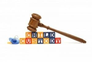 gavel on words child custody representing need of legal representation in child custody matters